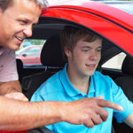 teenage boy learning to drive with instructor